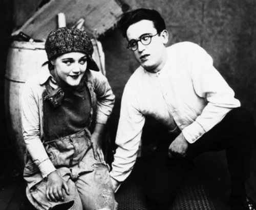 Film Fun Magazine, January 1921, original caption: Harold Lloyd and Mildred Davis pose for a film to be entitled, The Education of Young America