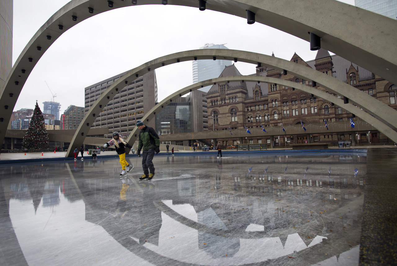 Skaters took to the ice at Nathan Phillips Square despite rain and warm temperatures, Sunday, December 2, 2012. (Galit Rodan for the Globe and Mail).