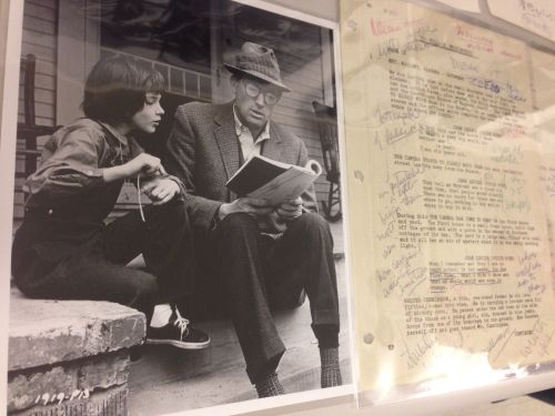 "A page from Gregory Peck's annotated script for ""To Kill A Mockingbird"" on the right. And on the left, a photo from the set of Peck going over lines with his 10-year-old costar Mary Badham."