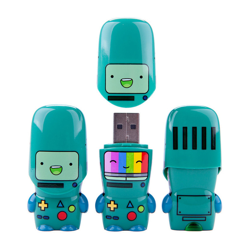 "The New BMO Flash Drive Now Available And, yes, it does compute. This flashy new Limited Edition BMO flash drive from the folks at Mimoco is out now. Premiering last week at SXSW in Austin, the BMO Rainbow MIMOBOT ""comes preloaded with an exclusive desktop interface featuring Mimory® content like a full Adventure Time episode and our MimoDesk® personalization suite, which includes BMO-themed wallpapers, icons, and avatars."" There are only 2,000 of these available, so you better get a move on with that credit card. Read more about the BMO Rainbow MIMOBOT here."
