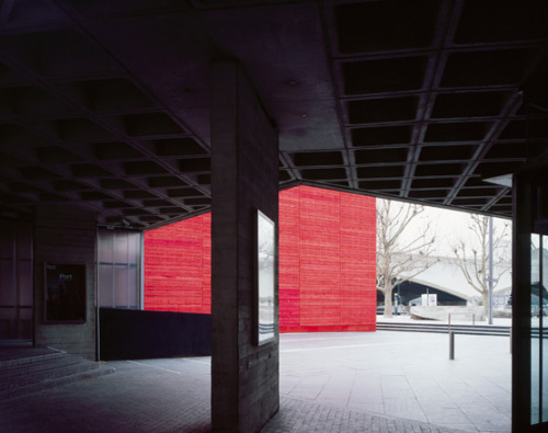 The Shed theatre by Haworth Tompkins   A bright red new landmark has sprung up amid the concrete architecture on London's South Bank. The Shed is a temporary venue for the National Theatre's impressive program of shows, and adds to the South Bank's already powerful cultural pull. Wallpaper*