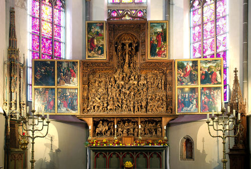 High Altar of Saint Nicholas Catholic church in Kalkar, North Rhine-Westphalia, Germany. This church has one of the most significant inventories of medieval sacred art in the region, and features an intricately carved, and extremely elaborate, crucifixion tableau in the reredos.