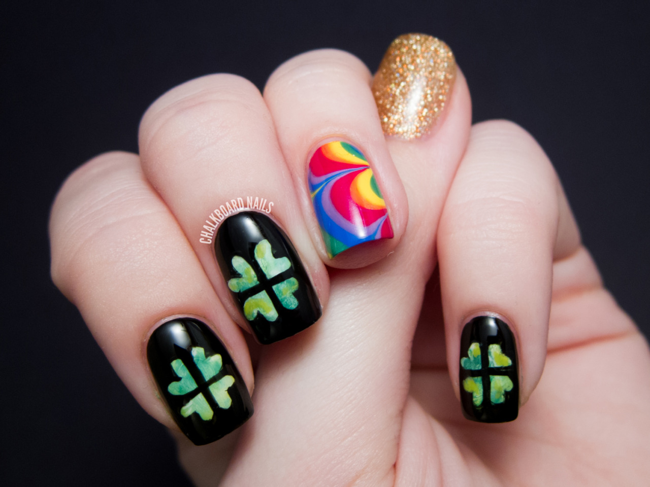 St. Patrick's Day Nail Art Featuring watercolored shamrocks, water marbled rainbows, and lots of gold! More details at the link above.