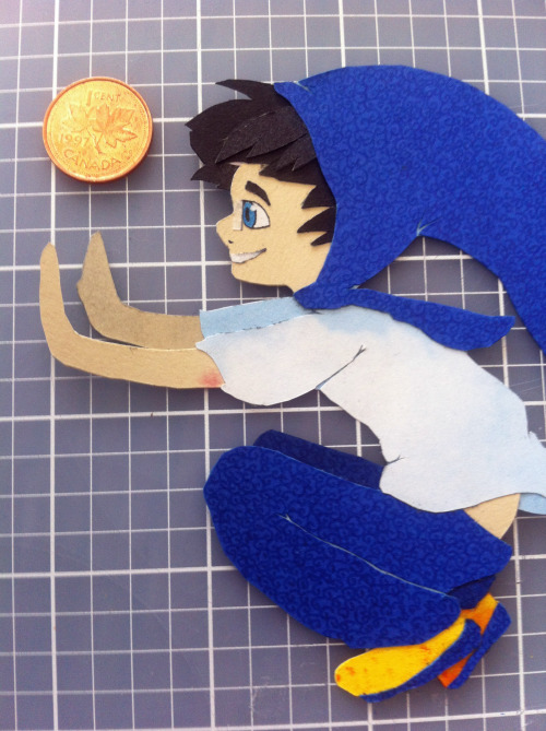 nicolesarts:  I tried my hand at papercraft with John~ He's fairly small(as you can see as compared to the penny) and he isn't attached to a background, so i can just pick him up and have him do the windy thing wherever i want. :3 My mom had lots of scrap-booking paper that i borrowed, but i drew the pattern on the hood/pants/shoes myself with a pen. I'm pretty happy with how it turned out, but definitely going larger scale next time so the little details aren't so difficult to cut and glue ahaha.