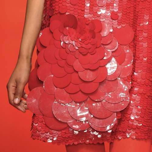 Close-up on @jasperconran's oversized paillettes - stunning. #lfw