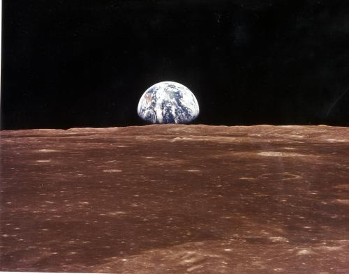 A view of the Earth appears over the lunar horizon as the Apollo 11 Command Module comes into view of the Moon before astronauts Neil Armstrong and Edwin Aldrin Jr. leave in the Lunar Module, Eagle, to become the first men to walk on the Moon's surface. [The first post to this blog was the famous earthrise from Apollo 8 - ed]