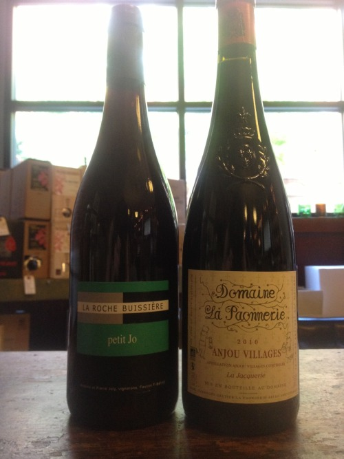 NEW WINE ALERT! La Roche Buissiere Petit Jo: This brilliant French Grenache is simple and fresh and postively exuberant.  It's also a rebel. Petit Jo made with just the grapes and the natural yeasts found on their skins, they add no sulfites, no designer yeast, no oak… it's purely a bottle full of delicious, easy-drinking, honest grape juice- who can argue with that? And it's an incredible value at $15 on the shelf! Domaine La Paonnerie La Jacquerie Anjou Villages 2010: This supple sipper is green, green, green- the family owned vineyard boasts organic and biodynamic farming, recycled paper labels, and even organic beeswax treated corks! And the wine is outstanding.  A blend of Cabernet Franc and it's progeny Cabernet Sauvignon (a genetic cross between Cab Franc and Sauvignon Blanc), La Jacquerie is earthy and vibrant, with red and black fruit and delicate structure.  $20