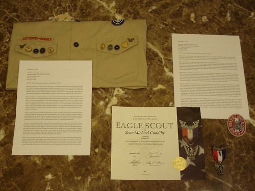 "I decided to return my Eagle medal and wrote a letter to accompany it. To show his support, my dad (who still helps my old Troop as an Assistant Scoutmaster) gave me his uniform shirt to send in along with it and wrote an amazing letter which I include below as well. I couldn't be more grateful to my incredible family (my little brother also intends to return his Eagle award!). Here's my letter: December 11, 2012 National Council, Boy Scouts of AmericaAttn: Wayne Brock, Chief Scout Executive1325 Walnut Hill LaneP.O. Box 152079Irving, TX 75015 Dear Mr. Brock and Esteemed Members of the National Council, Thank you for your service to and on behalf of the Boy Scouts of America. I had the privilege of participating in your organization throughout my childhood, and I owe you and your predecessors a great deal of gratitude for my experiences therein. My name is Sean and, until today, I was a gay Eagle Scout. From second grade through senior year of high school, I enjoyed hundreds of meetings and trips with my Cub Scout Pack and Boy Scout Troop. Those young men and their families have served as an incredible group of friends and role models, teaching me practical skills as well as values I cherish, including personal honor, civic engagement, and appreciation for the natural world. I remember my time as a Scout fondly, I'm proud that my family remains close with other families we met through Scouting, and I certainly appreciate what you've done to enable such meaningful connections. Most of all, I'm grateful to the BSA for all the time it helped my family spend together. From canoeing trips (where my Dad and my little brother made sure everyone had fun, no matter how many people they had to splash) to Troop meetings (where Mom tried week after week to get all the guys in my patrol to please keep track of our lunch money for the Personal Management merit badge), Scouting provided countless opportunities for the four of us to come together, bond as a family, and give back to our Troop community. I'm proud to say that my parents both still make time to volunteer with the Troop, providing valuable training and leadership. In over a decade of Scouting, one of my very proudest moments was giving my parents their pins—including Dad's mentor pin—while my brother looked on as master of ceremonies at my Eagle ceremony. It wasn't until a few months after that ceremony, during a difficult conversation with an incredible friend, that I admitted to myself that I was probably gay. It's a testament to the strength of my family that I immediately turned to my parents for help and advice. As I cried at our kitchen table and heard them say that of course they still loved me, and that everything was going to be okay in our family no matter what my orientation turned out to be, my relief was overwhelming. In the years since then, they and my brother have worked hard to overcome their own misgivings regarding homosexuality and become fierce supporters, all while showing more love than I could ever ask for. I won't pretend that it was fun for me to agonize over every smallest stirring of a same-sex crush—even while trying to ignore and suppress it—because I thought it would destroy my hopes for a meaningful career and a happy family. I certainly didn't enjoy confessing to my friends that I'd been deceiving them, even though I could honestly say that I'd been deceiving myself as well. But the sad fact is that, compared to most lesbian, gay, bisexual, and transgender (LGBT) kids, I've had a remarkably easy time coming out. In less tolerant homes and communities, wildly disproportionate numbers of such youths become victims of violence, homelessness, depression, and suicide. The BSA's homophobic policies—to which you have once again committed yourselves—help perpetuate that deadly culture of intolerance. Of course I'm well aware of the case in which a narrow majority of Supreme Court Justices declared that your policies count as constitutionally protected expressive association. But before you doubled down this past July, I hoped that in the twelve years since Boy Scouts v. Dale you might have come to recognize the harm that your discrimination nevertheless inflicts on LGBT people—be they closeted Scouts and Scouters, would-be participants who are openly LGBT, or simply unaffiliated Americans who cringe to see their neighbors' ignorance enshrined in the policies of one of our nation's largest and most beloved civic organizations. I hoped that, at the very least, you would speak out and differentiate your position from that of hateful pundits who insist that loving gay families are no more ""morally straight"" than drug addicts or pedophiles. Instead, you've once again prioritized a futile effort to protect straight Scouts from the very notionof homosexuality. You've decided that letting some misguided parents and religious leaders spread their own views unchallenged is so important that you can't risk allowing real gay people to coexist as counterexamples. You've even kept individual Councils from adopting more inclusive policies in keeping with their own beliefs, a clear violation of that same principle of honoring parents' and faith communities' moral self-determination. The inescapable conclusion is that either you remain under the influence of harmful and outdated misconceptions regarding LGBT people or, worse, you recognize them as false and dangerous but lack the courage to reject them. I hope that this letter, or one of the many others like it submitted by my fellow former Scouts, will convince you of the wrong-headedness of your current discriminatory practices. In the meantime, however, I will not cling to an award that you insist I don't deserve. Enclosed are my Eagle Scout certificate, patch, and medal. Although your recent actions have provoked justifiable anger among gay people and our loved ones, I hope you will not take this letter as a simple condemnation of the BSA. Someday I intend to raise children and provide them with as much support, stability, and love as my family has given me (though I recognize that that will be an enormous undertaking). I hope that by then you will have changed your policies and that any sons I have will be Boy Scouts, because I know first-hand how much your organization has to offer. But I worry that if you fail to accommodate LGBT people, the once-proud BSA will soon fade into irrelevance among the ever-growing number of Americans who recognize the harm your policies inflict on us. Honestly, we don't want much: as proud as I am of the culture that LGBT people have created, I don't think Troops have to march in Pride parades or offer LGBT History merit badge courses. All I ask is that you stop punishing kids and parents brave enough to be honest about their innate identities. Thank you for taking the time to read this letter. I hope you will find it useful as you continue to work to benefit the amazing national community of Scouts and Scouters. Sincerely, Sean Cuddihy Enclosures Here's Dad's letter: December 11, 2012 National Council, Boy Scouts of AmericaAttn: Wayne Brock, Chief Scout Executive1325 Walnut Hill LaneP.O. Box 152079Irving, TX 75038 Dear Mr. Brock and Esteemed Members of the National Council, Thomas Jefferson is one of my heroes. My Father, my wife and I attended the University that he founded, and I often think about what he might do in difficult situations. Both as our nation's third President and in managing his private life, Jefferson faced many monumental challenges, and in 1820 he wrote a letter to a colleague about one of the defining struggles of his life, saying ""But as it is we have the wolf by the ears, we can neither hold him, nor let him safely go. Justice is in one scale, and self-preservation in the other."" For over a decade now, the Boy Scouts of America have been at the center of a conflict that seemed to pit justice, in the form of non-discrimination, against preservation of the institution's values. But now we, as leaders, must take responsibility to end the unfair treatment of people based on their race, religion, gender or sexual orientation. Specifically, we must recognize that the biases many of us, including me, held against gay people for many years with the intent 'to protect our boys' were actually based on ignorance. Today, with better information, we understand that there is no real self-preservation value in the Boy Scouts of America's intolerant policies, and that a behavior of intolerance to others different than you is harmful to everybody. I believe with 100 percent confidence that the Boy Scouts of America will one day stop discriminating. Having said that, the questions are: Will the leadership of Boy Scouts of America, which has been a significant part of my life for fifteen years, take the necessary action to be part of the evolution of justice? Or will the Boy Scouts of America continue to be the only nationally and once greatly respected organization that can't evolve itself in a reasonable time frame to eliminate discrimination? For me it is personal. My Dad is a proud Life Scout; my Mom was an enthusiastic Den Mom. I joined Scouting over forty-five years ago. My wife and I are the proud parents of two Eagle Scouts and our whole family has been deeply engaged with the Boy Scouts of America. There is no measure to the joy and fulfillment that the Scouting Program has enabled for my family over many years and the lifetime friendships that have resulted. My wife and I still volunteer as Boy Scouts of America leaders, teaching merit badges, going camping, helping and shaping future leaders of America, and we know that this Program has exemplary benefits to both its participants and volunteers. Both my sons gained everything one could ever expect from the Scout Program including great leadership skills, earning valuable merit badges, and making lifelong friends. I could not be prouder. They both rightfully earned their Eagle badges. However, I want you to know that both my sons now want to return their Eagle awards and I have advised them against it. As the eternal optimist, I told them I believe that it is self-evident that the Boy Scouts of America will do the right thing and eliminate their discriminatory policies sooner rather than later. While there is abundant evidence that the world is becoming a more tolerant place, frankly, there is no evidence to support my optimism that the Boy Scouts of America is even moving in the right direction. Specifically, my younger son, who is now also an Assistant Scoutmaster, wanted to send his Eagle badge to a young man who was recently denied his Eagle award by the Boy Scouts of America for being gay. Other Eagle Scouts sent their Eagle awards to the discriminated against Scout first, so my son still has his award, but I am proud of his generosity of spirit and believe his selflessness matches the stated values of the Boy Scouts of America. My older son is arguably one of Scouting's best Eagle Scouts, and his accomplishments are astonishing, not just as a proud parent but by any standards. He lives by and meets the intent of the Scout Oath and Scout Law better than any person I know, and everybody that knows him likes him and respects him. He is humble and I assure you that you would like him too. If I ever was stuck on a deserted island; I would want him to be with me for his integrity, generosity and skills as an outdoorsman. Among his many awards include being the valedictorian of his High School and graduating with honors from Harvard. He is everything you could possibly dream of as a son and an Eagle Scout. At the risk of sounding arrogant, as he heads off for law school next year, I will tell you that it is not out of the realm of possibilities for him to be President of our country one day. He is an Eagle Scout that sets an example for all of us to exemplify and you should be proud of him as a person. Oh, by the way, he is gay. I can tell you that you are just wrong to believe he is not worthy and not representative of what the Boy Scouts of America claims to stand for. Like the leadership of the Boy Scouts of America, Thomas Jefferson also struggled with discrimination being wrong, but he did point us in the right direction when he wrote that ""all men are created equal."" I recognize that you have the right to discriminate in a private organization but that does not make it the 'right thing to do'. Today, as we have the wolf by the ears, it is clear what we must do. It is time for us to admit that our prejudices and feelings of discomfort, that so many of us held in the past that were based on ignorance, are wrong and harmful. It is time to lead the world with actions that enable justice to prevail over a once misunderstood threat of self-preservation. It is time for us to stop being hypocritical of the Scout Oath that claims we are morally straight. It is time to improve our outdated policies that discriminate. It is time for us, most importantly, to stop sending the message to our young people and the world that it is okay to discriminate and that someone is not good enough to be in the Boy Scouts of America because of their race, religion, gender or sexual orientation. I am deeply saddened and disappointed by your continued hypocrisy and at your refusal to stop discrimination. My older son has written you a letter, a far more eloquent one than mine, that returns his well-deserved Eagle badge to you. I have asked him not to send it back because he earned it and I don't think it will change your way of thinking. However, he is doing it on principle and I will support him. To his credit, he is not angry at you; he is a far better man than me. Even though by now you have probably heard thousands of stories like mine, I still feel obligated to tell you that I am ashamed of the Boy Scouts of America leadership. The Boy Scouts of America leadership blatantly discriminates against deserving people, and refuses to evolve with the rest of the world, including the policies of the President of the United States, the U.S. military, and leading American companies. As a long standing Boy Scouts of America leader and a responsible citizen, I am asking you to change your policy that discriminates, teaches intolerance and harms everyone involved. I can no longer wear the Boy Scouts of America uniform while the Boy Scouts of America leadership continues to discriminate. I am returning my Boy Scouts of America shirt, which is not decorated with many colorful patches and awards, but rather eight simple pins, symmetrically arranged on the pockets, which are dear to my heart:·         Two Eagle Scout Mentor pins·         Two Eagle Scout Dad pins·         Two United States Presidential Volunteer pins·         Two Eagle pins presented to me for my support of another less fortunate troop of underprivileged boys that are wards of the County. Please respectfully care for this treasured and symbolic possession of mine until you evolve your policies and stop wrongful discrimination. I am including the cost for you to mail it back to me in the near future as an optimistic gesture that I will be able to wear my Boy Scouts of America shirt proudly again. More importantly, I ask you to take a speedy course of action 'to do the right thing.' Sincerely, Glenn Cuddihy Enclosures cc:   President Barack Obama        The Honorable Bill Nelson, United States Senate        The Honorable Marco Rubio, United States Senate        The Honorable Alan Grayson, United States House of Representatives Sorry for such a long post, but thanks for reading!"