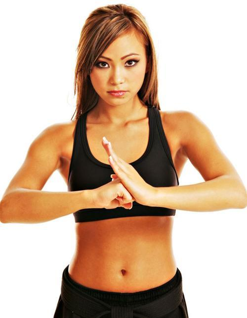 purposefulmusings:  Michelle Waterson, I believe. Took me a few seconds to realize she's wearing her Black belt :)