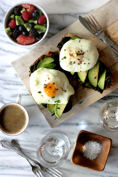 unmorceaudechocolat:  olive oil poached eggs on avocado toast.