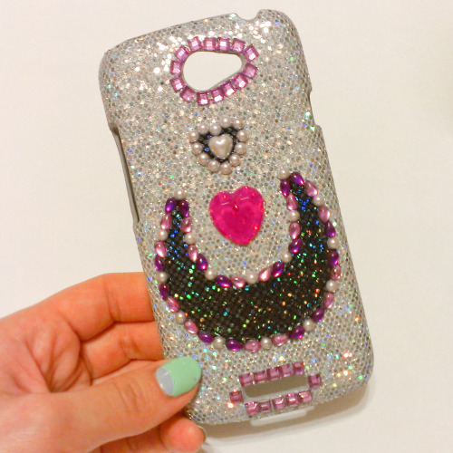 I finally decorated a case for my new phone! The silver glittery case was from this store on ebay, and I covered it in rhinestones and fabric I had lying around. c; If you're interested in decorating your own case, here are some good adhesives you can try: Fabri-Tac: Good for fabric on fabric bonds (I used it to glue the black moon to the case, since the case is more of a fabric texture than a plastic texture). Aleene's Jewel-It: Good for rhinestone on fabric bonds. Aleene's Glass and Bead Glue: AWESOME for attaching rhinestones, etc to plastic bases. It has a good hold and doesn't crackle the backing on rhinestones. Recommended to me by MissAlphabet and I am forever grateful. ♥ If you have any questions please feel free to send me a message, I'll do my best to help! :]