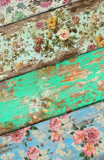 Unusual chintz floral printed wood. Love the beautiful worn colour and the effect made by the wood grain textures mixing with this classical print style.