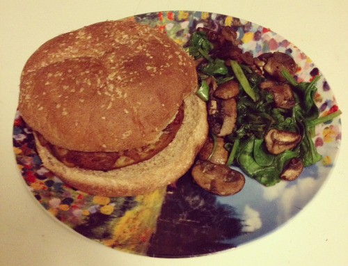 semisanityplea:  Indian masala veggie burger on a toasted whole wheat bun with sauteed spinach and mushrooms