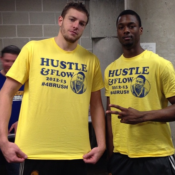 After a big win in Utah, David Lee and Harrison Barnes display their Brandon Rush tribute shirts.