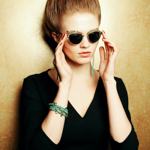 shutterstock:  Woman in vintage shades and turquoise jewlery. Photograph by Augustino