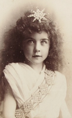 Girl in costume. 1880s