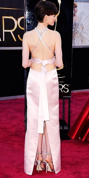 "Better From The Back? Anne Hathaway at the Oscars The star describes her pale pink Prada number as, ""Business up front, party in the back!"""