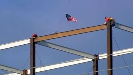 "KGO-TV reports that A 300-foot crane lifted a pair of gold-painted steel beams Thursday to top out the highest point of the planned $1.2 billion Santa Clara stadium that one executive said would be a ""software-driven"" venue when the San Francisco 49ers start playing there in 2014. 49ers CEO Jed York said the new stadium will bring a new technology-driven experience where fans use their smartphones during games for things like watching instant replays and making cashless payments for food and drinks at concession stands. ""It's more than just building an app,"" York said. ""It's watching plays from different camera angles from your phone, the (NFL game replay) RedZone channel on your screen, fantasy football. You want fans to choose. You want 60,000 different experiences in this stadium."" Last month, Intel Free Press reported on the hi-tech 'smart' features being worked into the new statium: 49ers Bet on Technology to Boost Fan Experience."