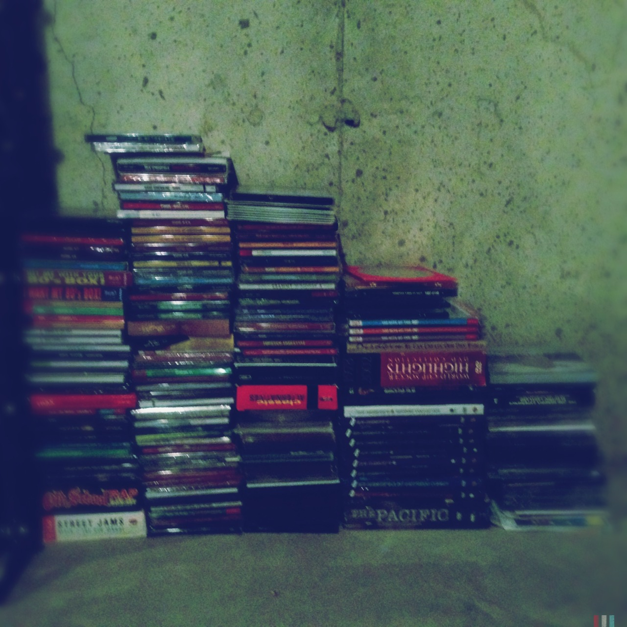 Bored and snapping things around my house. #cd #music #obsession #collection #basement #night