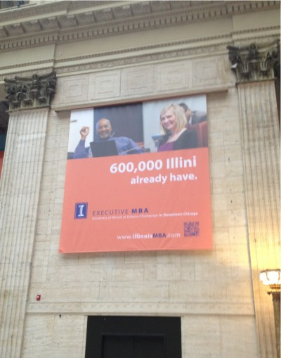 thisistheglamorous:  The University of Illinois has giant banners, about 20 or more feet in the air, hanging in Union Station to advertise their MBA program. One of them has a QR code for you to scan. You know, 20 feet up in the air. Pick your shitty punchline: 1. So, if you can figure out how to scan it, is that part of the entrance requirements? 2. How many MBAs does it take to think this was a good idea? At least one from U of I.  3. How many MBAs does it take to think people actually scan QR codes? At least one from U of I. 4. I've never seen real life application of what a MBA-wielding consultant said to do in real life before.