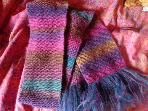 "tikibarbie:  Wisdom Yarns Poems Silk ""Almost Dusk"" (color 802) in garter stitch on size 8 needles with Debbie Bliss Angel Prints ""Renoir"" (color 9) as the fringe"