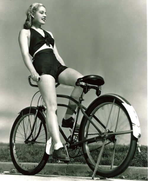 Mary Beth Hughes rides a bike. Backwards.