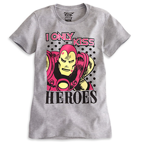"Avengers fans petition Disney to dump sexist t-shirts. #NotBuyingIt. That's the message many superhero fans are sending to Disney to protest a crop of new Avengers T-shirts that tell boys to ""Be a Hero"" and girls to ""Need a Hero."" As the highest-grossing movie of 2012, The Avengers was a major success story for Disney and Marvel's flagship superhero franchise. Its merch has taken some super-backlash, even prompting a Change.org petition titled ""Stop Selling Sexist T-Shirts @DisneyStore.""  Feminist campaigners Miss Representation explained the situation: ""The Disney Store is selling Avengers T-shirts for women with the slogan 'I Need a Hero' and 'I Only Kiss Heroes,' and an Iron Man T-shirt for boys that reads 'Be a Hero.'"" These shirts promote the idea that men and boys are meant to do the saving, and that women and girls are the ones who need to be saved."" In addition to the message sent by the ""I Only Kiss Heroes"" slogan, the Disney webstore stocks T-shirts and costumes for all five of the male Avengers—but none featuring Black Widow, the only female superhero in the 2012 movie. [READ MORE]"