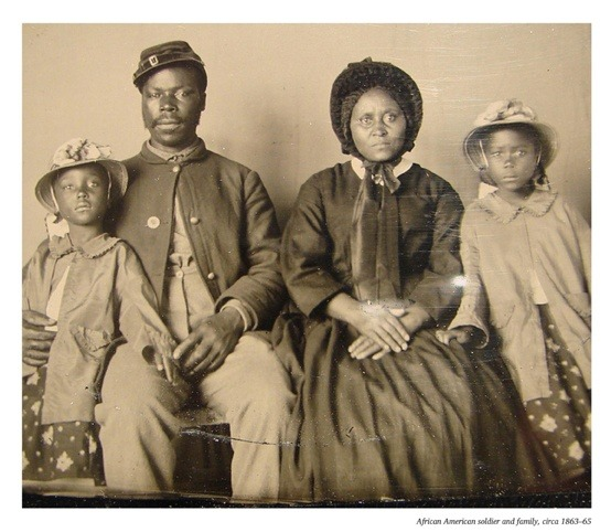 Union soldier with his wife and two daughters.