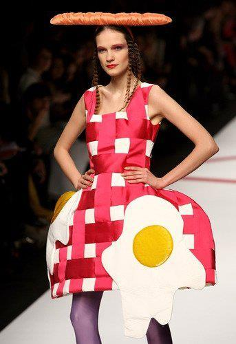 "Weird Fashion #1 - ""Putting the 'egg' in 'egg-fashion'""FB Caption Contest winner, Allen Chiu! Runner up - ""Breakfast on Tiffany's"" - Benoit CornetTo see the full list of entries, check them out here."