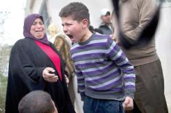 A Palestinian child reacts after coming back from school to find his house destroyed by the Israeli occupation forces, east of Jerusalem, today .