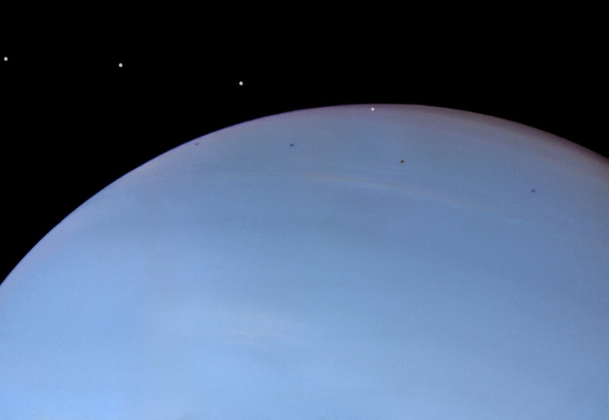 Despina, Moon of Neptune   Credit:  NASA, JPL, - Processed Image Copyright: Ted Stryk http://apod.nasa.gov/apod/ap090903.html  Despina is a tiny moon of Neptune. A mere 148 kilometers across, diminutive Despina was discovered in 1989, in images from the Voyager 2 spacecraft taken during its encounter with the solar system's most distant gas giant planet. But looking through the Voyager 2 data 20 years later, amateur image processor (and philosophy professor) Ted Stryk discovered something no one had recognized before — images that show the shadow of Despina in transit across Neptune's blue cloud tops. His composite view of Despina and its shadow is composed of four archival frames taken on August 24, 1989, separated by nine minutes. Despina itself has been artificially brightened to make it easier to see. In ancient Greek mythology, Despina is a daughter of Poseidon (the Roman god Neptune).