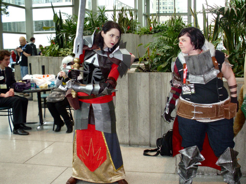 fearandlothering:  Emerald City ComiCon, Day 2 | Part 1 of ??? Fanfic is going to make this Evangeline vs. Hawke thing a reality. Because I'm going to write it. Though I didn't quite know how much I wanted it until this afternoon. It's really crazy to randomly run into cosplayers you admired the fuck out of before even attempting to cosplay from said fandom, it's a little like being starstruck. I feel so unworthy, holy crap. [Hawke: fearandlothering (duh) | Evangeline: hemisphere]  Can I just say that I'M GLAD THIS PICTURE TURNED OUT WELL? Seriously, I am so sorry that my hands in the gloves were NOT agreeing with your phone :( At least Jenny managed to snap it for me. Your costume turned out wonderfully! (also I've been giggling at your username since I first saw it whenever ago, so it's great to put a face to the name, so to speak! :D)