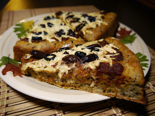 reblogged from ibtk:  Olive you, Kalamata pizza crust!  So I made this and it was pretty awesome. Kalamata olive crust topped with homemade pizza sauce (made and frozen in the fall), mozzarella Daiya, and black and Kalamata olives. I scored a 4 1/2 pound jug of Kalamata olives on Amazon and have been putting them on all the things. SO GOOD.