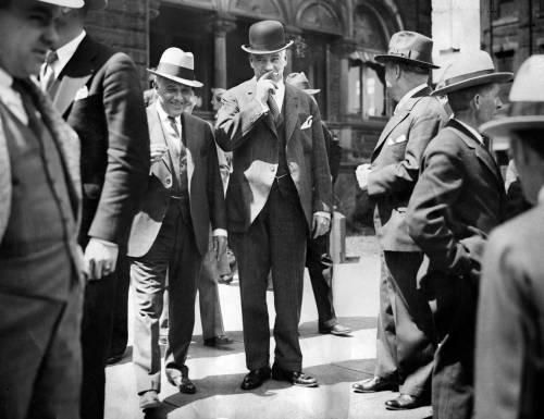 "May 2, 1932: ""The trial of Pittsburgh Mayor Charles Kline"" The date stamped on the back of this picture suggests it was made during the first day of former Mayor Charles Kline's trial on charges of malfeasance. After his conviction, The Pittsburgh Press editorialized, ""The little machine henchmen with their knowing smiles …. now know that no political machine is all powerful."" Charles Kline (he's the one smoking the cigarette) can be remembered for many things: He was a dapper dresser, and during his administration the skyline grew to include the Gulf Oil Tower, the Grant Building and the Koppers Building. He loved greeting famous people who visited the city. One day we'll post a collection of pictures of Kline welcoming notable folks — among them President Calvin Coolidge, Charles Lindbergh, Mary Astor, Richard Byrd and Gene Tunney. Kline also was the last Republican elected mayor of the city. But perhaps Kline is known best as the city's most corrupt politician. His trouble began with the purchase of a $1,350 rug he said would ""dignify the mayor's office."" That purchase fueled a controversy that led to Kline's indictment in a purchasing scandal. Kline was sentenced to jail, but never served because of ill health. He died a few months after his conviction. The infamous Kline rug remained in the mayor's office, becoming threadbare over the years, until Sophie Masloff ordered it removed in 1992. (Photo credit: Unknown) — Steve Mellon"