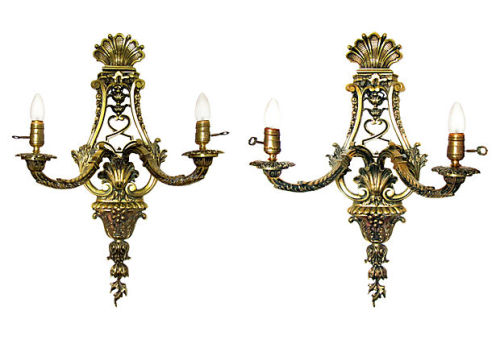 Pair of very large French Louis XIV-style two-arm brass sconces, circa 1910. Wired and in working condition. Sold by Ruby + George on One Kings Lane Vintage and Market Finds