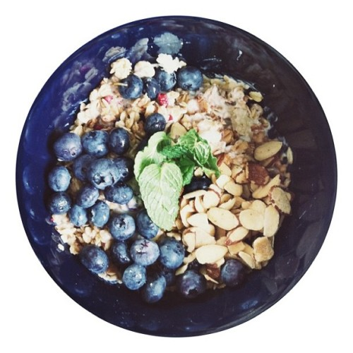 Morning. Organic. Blueberries. Goat milk yogurt. Quinoa. Granola. Almonds. Honey. Mint.