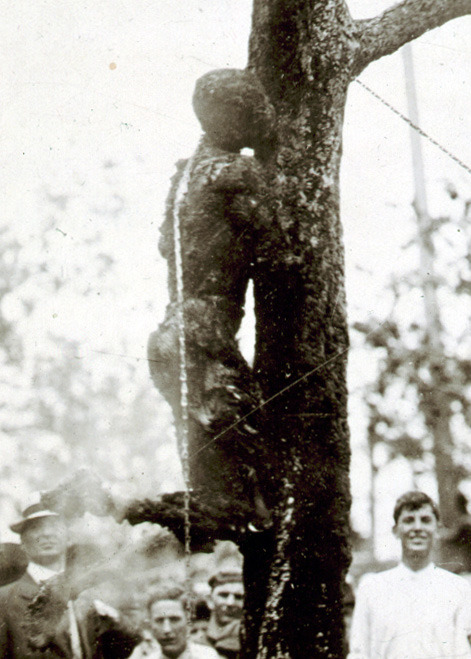 historicporn: The lynching of Jesse Washington.Washington was beaten with shovels and bricks,was castrated, and his ears were cut off. A tree supported the iron chain that lifted him above the fire. Jesse attempted to climb up the skillet hot chain. For this, the men cut off his fingers.Jesse was 15.1916.