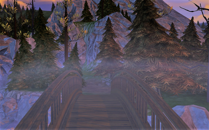 A wooden bridge crosses over a gap. A fog hangs over the bridge.