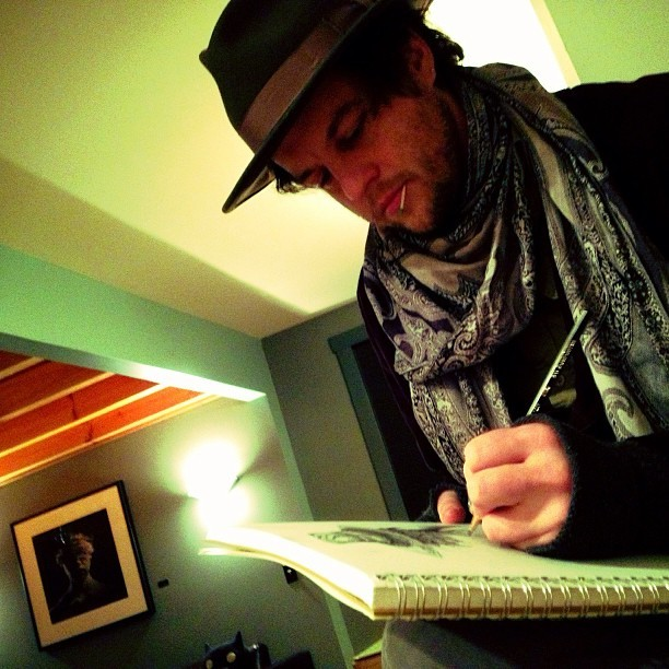 Ror caught a shot of me sketching my last drawing of 2012. #corybasilart  (at studiovilla)