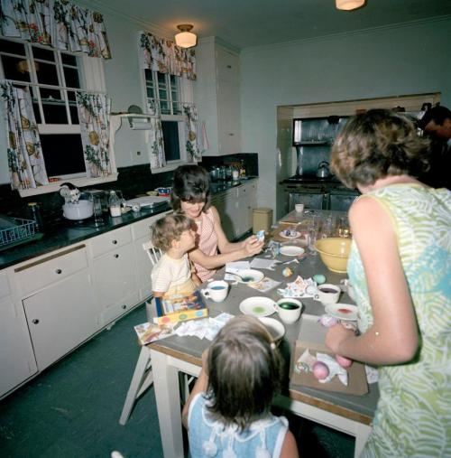 Are you decorating eggs for Easter? The Kennedy family did! Here's an image from the Kennedy's April 1963 Easter vacation in Palm Beach, Florida, where Mrs. Kennedy is teaching John Jr. the fine art of Easter egg design.