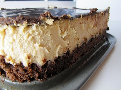 healthybreakfastblog:  Peanut Butter Cheesecake with a Brownie Crust   Preheat the oven to 350°F. Grease and flour (or spray with baking spray) a 9 x 9 square or 10″ round springform pan. Melt the butter and stir in the cocoa powder. Cover, and set aside to cool. Using an electric mixer, beat the eggs for 3 minutes (longer if you're using a hand…  Post has been published on http://turvs.net/peanut-butter-cheesecake-with-a-brownie-crust/