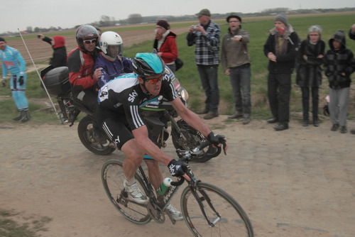 Mathew Hayman | Paris-Roubaix 2012 on Flickr.Via Flickr: Paris–Roubaix is a one-day professional bicycle road race in northern France near the Belgian frontier. From its beginning in 1896 until 1967 it started in Paris and ended in Roubaix (hence the name); since 1968 the start city has been Compiègne (about 60 kilometres (37 mi) north-east from Paris center) whilst the finish is still in Roubaix. Famous for rough terrain and cobblestones (setts),[n 1] it is one of the 'Monuments' or Classics of the European calendar, and contributes points towards the UCI World Ranking. It has been called the Hell of the North, a Sunday in Hell (also the title of a film about the 1976 edition of the race), the Queen of the Classics or la Pascale: the Easter race.[1] The race is organised by the media group Amaury Sport Organisation annually in mid-April. First run in 1896, Paris–Roubaix is one of cycling's oldest races. It is well known for the many 'cobbled sectors' over which it runs, being considered, along with the Ronde van Vlaanderen and Gent–Wevelgem to be one of the cobbled classics. Since 1977, the winner of Paris–Roubaix has received a sett (cobble stone) as part of his prize.[2] In recent years, the terrain over which Paris–Roubaix runs has led to specialized bikes, with unique frames and wheels, being used. Wheel punctures and other mechanical problems are extremely common because of this terrain, and often play a part in who is able to ultimately make it to Roubaix with momentum. Despite the high esteem with which the race is seen, some notable cyclists throughout history have regarded the race as a joke because of its difficult conditions. The race has also seen several controversies over the years, with many seeming winners of the race disqualified for various reasons. The course is maintained by Les Amis de Paris–Roubaix, a group of fans of the race formed in 1983. The forçats du pavé seek to keep the course as safe as possible for riders while maintaining its difficulty.