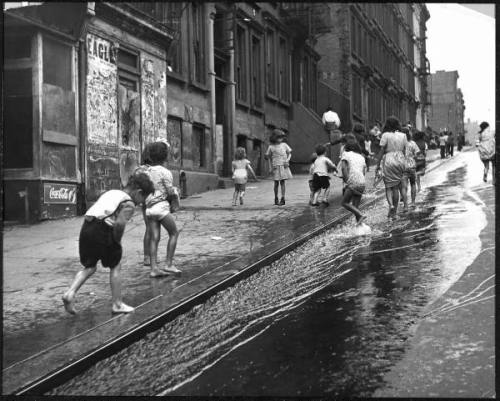 collectivehistory:  Children playing on 103rd street in Puerto Rican community in Harlem, 1947, by Ralph Morse