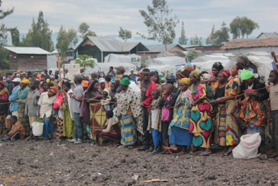 "Photo: People queue for food distribution in Mugunga III camp. DRC 2012 © Aurelie Baumel/MSF DRC: High Levels of Sexual Violence in Goma Camps People displaced by armed conflict around Goma are now suffering high levels of sexual violence in and around the camps where they have taken shelter. Between December 3, 2012, and January 5, 2013, the MSF team working in Mugunga III camp, a few kilometers west of Goma, registered and treated 95 patients who were victims of sexual violence, with a notable increase in late December. MSF denounces the lack of action on the part of those responsible for protecting civilians and the poor security conditions in the Goma camps.  ""The camps and surrounding villages face a glaring lack of security,"" said Thierry Goffeau, MSF head of mission in Goma. ""The responsible authorities and the leaders of the various armed groups all claim—without exception—that they are defending the civilian populations. They must thus assume their responsibility and ensure that the most vulnerable are not subject to violence or reprisals."""