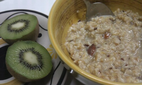 Maple and brown sugar steel cut oats with almonds and a kiwi.