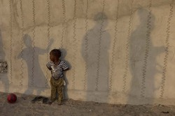 Children play in front of a decorated house wall in Saint-Louis, Senegal on May 19, 2013. [Credit : Rebecca Blackwell/AP]