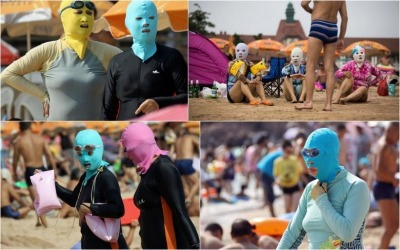 "A new kind of swimwear trend is sweeping the Chinese beaches in Qingdao in eastern China's Shandong province. As the weather get hotter, both men and women are seen appearing on the beaches wearing full body suits that cover from head to toe. The upper part of the swimsuit has a ski-mask with holes cut out at appropriate places to leave the eyes, nose and mouth exposed, giving the wearer an odd Lucha libre look. The Netizens are calling the swimwear ""face-kinis""  Why, my peoples. Why? D:"