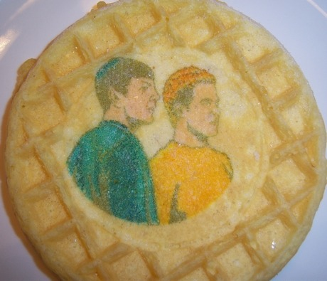 incorrigiblerobot:  Star Trek Waffles - Neatorama (via Scott McNulty) With the Jewish Leonard Nimoy in a yarmulke and the Canadian William Shatner in a toque. Poor color saturation or racism, Kelloggs? Man, I eat me a mess-o-Eggos but I would never eat these. Bag and board them, yes, but never eat.   I ate Uhura.
