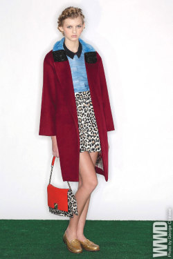 womensweardaily:  Fall 2013 Trend: Prim Witted Haus Alkir's cashmere and wool coat with lamb fur collar embellished with Swarovski Elements and eelskin and cotton top; Kate Spade's collared silk blouse, cotton skirt and leather handbag. Bass loafers.