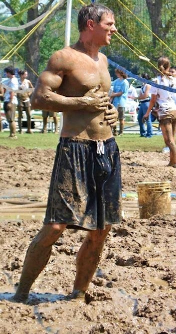 Muddy frat boy in shorts - showing off his bulge.